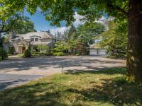 Graciously situated on over one acre, and across from