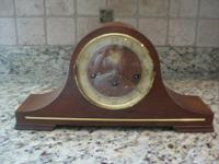 This is a beautiful old clock. The wood case, dial and