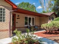 Charming Mid-Century brick ranch home with 3 bedrooms,