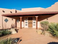 This exquisite Santa Fe custom home boasts of beautiful