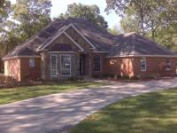 UP FOR SALE IS A 2081 SQUARE FOOT BRICK HOME SITTING ON