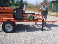 THIS 2009 WOOD-MIZER 26HP CAT DIESEL TWIN BLADE EDGER