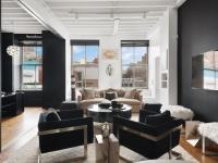 Sun floods this dramatic prewar condominium loft with