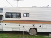 27' 1983 Chevy Honey Motor home (in RV Park) for sale.