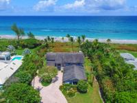 Set on a one-of-a-kind, one acre ocean front lot