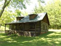 Custom built log cabin on a beautiful 144 acre farm