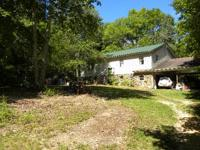 4BR/3BA - 2 story home on 201 +/- acres. 6 spring fed