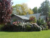 Home on 1.29 acres with 2 board fenced horse pastures,