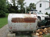 Old heavy gauge 275 gallon oil tank that is one fourth