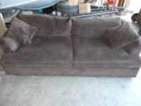 McCreary Modern Furniture Dark brown Sofa. This sofa