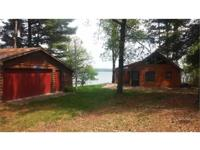 MANTRAP LAKE LOG CABIN. ABSOLUTE REAL ESTATE AUCTION!
