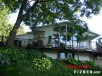 This home is located 1 mile from lake access. The house
