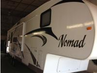 This is a 2011 Nomad 3055. It was bought new in October