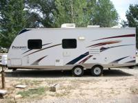 Well-kept 28' Ultralite camper-trailer with pop-out.