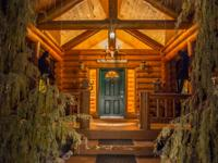 This picturesque 3 bedroom log home is situated on 1.5+