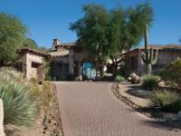 Situated on an elevated and private golf course lot,
