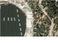 This 1.74 acre property on Spring Lake is scenic and