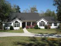 Beautiful home in town.Circle drive, nice privacy, oaks