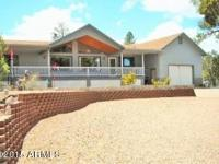 Drive into this very private, landscaped Chalet home