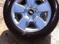"FOR SALE 4-20"" FACTORY CHROME CHEVY TIRES AND WHEELS."