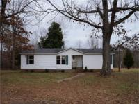 Doublewide on a rolling 20 acre parcel of land. There