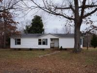Doublewide on a rolling 20 acre parcel. There is an