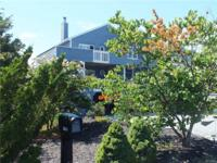 Located in the gated community of Breakwater Beach,