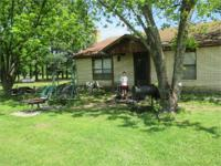 This nice brick home sits on 25 acres. Its fenced and
