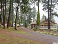 Private retreat nestled in the forest, has a lawn area,