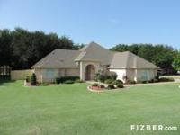 This immaculate executive home rests on.6 acre lot