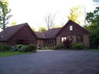 house, rough sawed cedar siding ,finished basement,