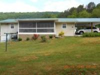 2 Houses and 25 acres of land. located between Bays