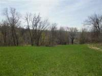Just under 5 acres. About 35 minutes north of Dubuque