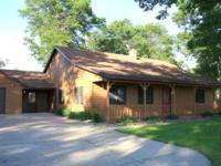 Beautiful ranch style (cedar sided) home and garage on