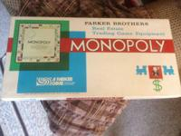 I have 2 1970 Monopoly games by Parker Bros.I believe