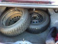 I have 2 used  215/60 R16 snow tires on rims. They have