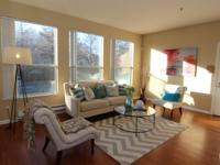 This cozy condo has it all! Open floor plan with