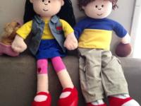 2 English/Spanish Language Littles dolls. They each