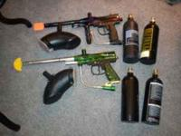 2 like new nice Spider paintball guns with hoppers and