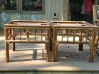 These are a pair of rattan, glass top, end tables. I