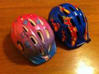 2 toddler bike helmets. One boy and one girl. $5 for