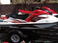 Pair of Yamaha jet skis with dual trailer for sale.