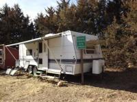 26' Mallard Camper, sleeps 6 with Queen Bed in a