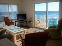 Enjoy your beach vacation in this top floor direct gulf