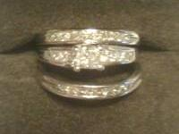 This diamond wedding set totals 2 carats. It is 14k