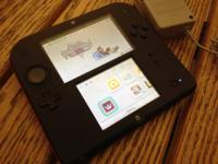 Selling my 2 months old 2DS. It's black and red.