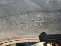 Firestone tires on the rims. 1 is a size 11.2-28 the