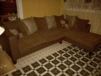 2pc brown and tan sectional new. ann . Location: