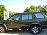 This is a used 1997 Nissan pathfinder SE 4x4. The