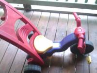 Fisher Price Rock, Roll -n- Trike Start it off as a